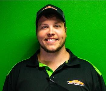 matt robertson, project manager, male employee in front of green wall