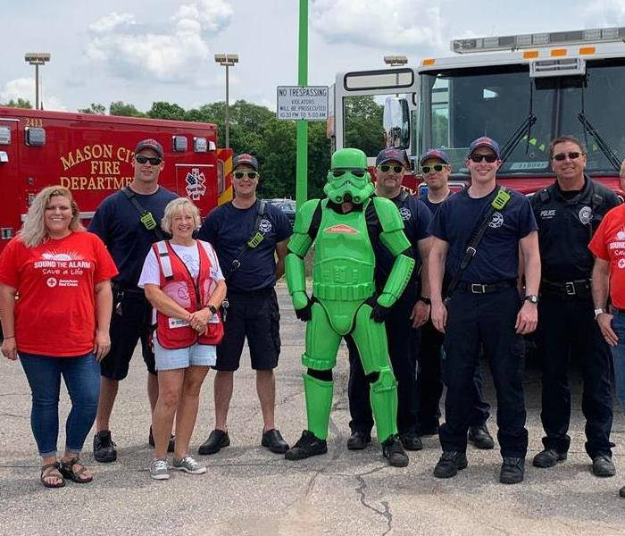 Green Stormtrooper with fire department personnel and volunteers